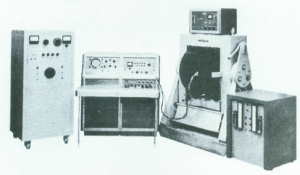 An early Varian CW-NMR spectrometer.  The power supply, control panel, magnet, and cooling unit (left to right) are visible [3]