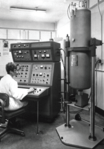A technician operates a Varian HR-200 NMR spectrometer.  Reproduced from [5].